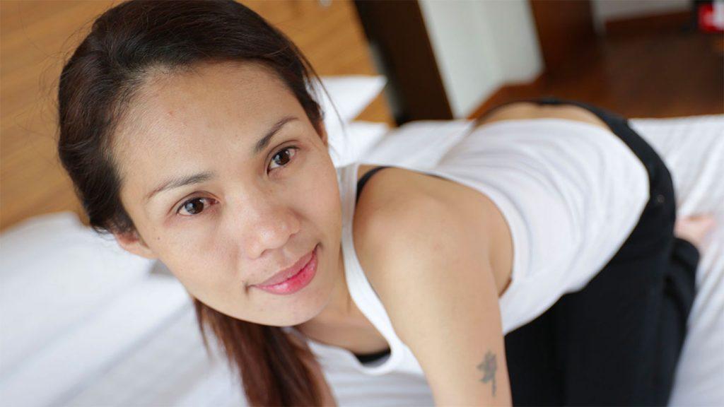 Cute Asian MILF in jeans smiling